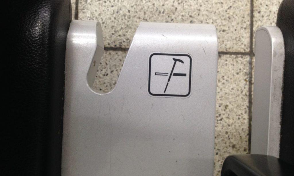 Chain holder subway station Tokyo Japan