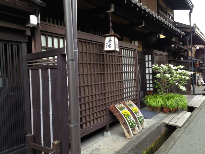 Old shops in Sanmachi Suji historic district in Takayama village Japanese Alps