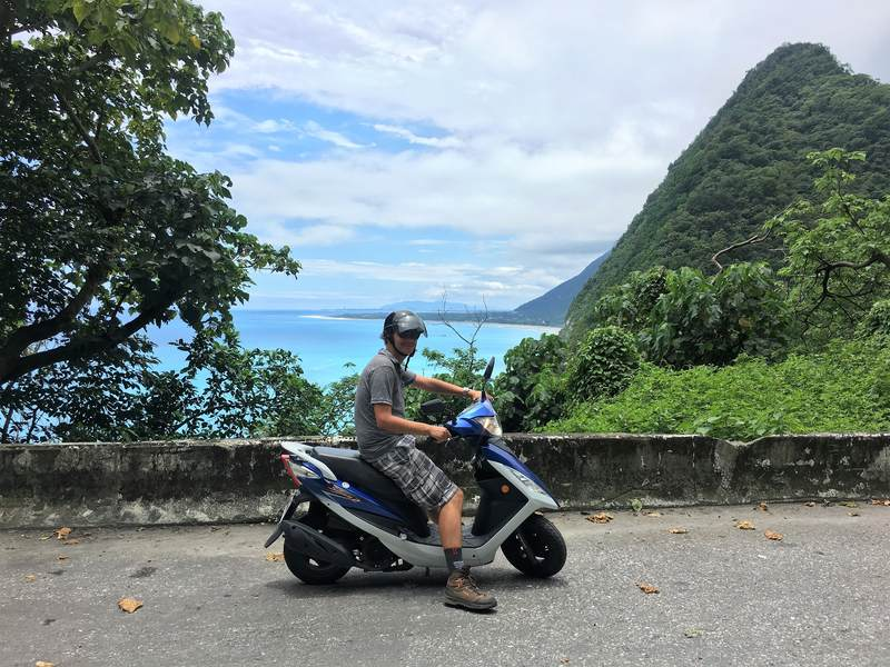 View of scooter in front of cliffs near Hualien