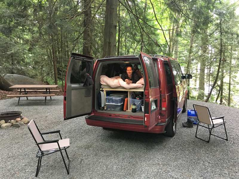Small converted campervan at campsite in Canada
