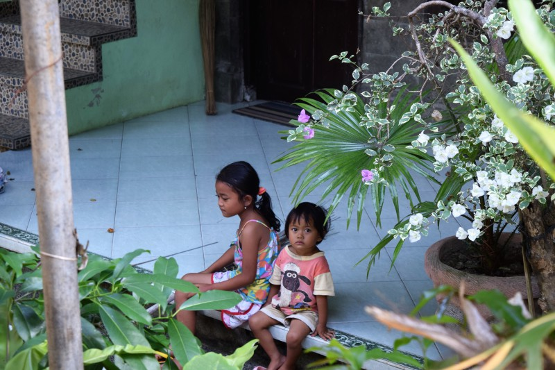 Two Balinese girls sitting on porch