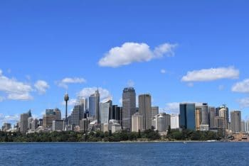 Sydney harbor - city skyline with Opera Building and Harbor Bridge
