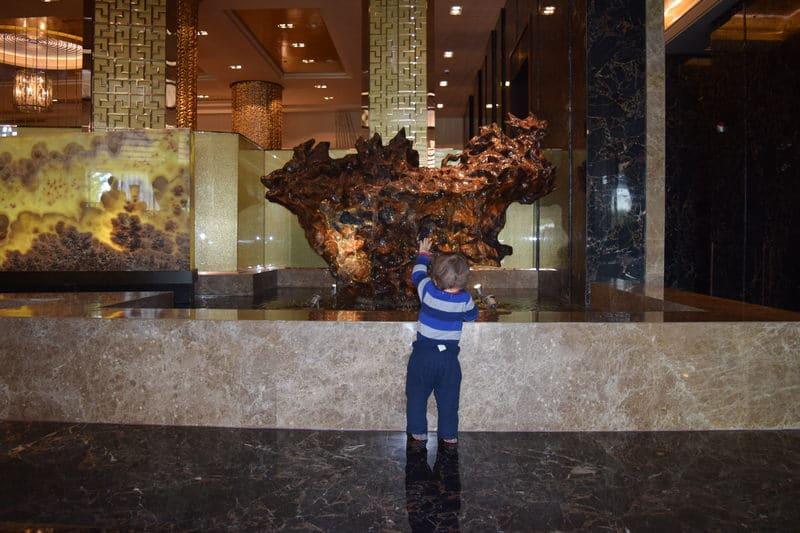 Baby admiring art in the Zhaolin Grand Hotel