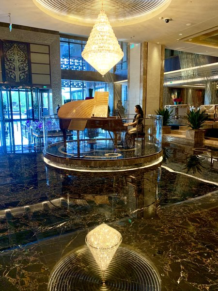 Lady playing the piano at the Zhaolin Grand Hotel Beijing