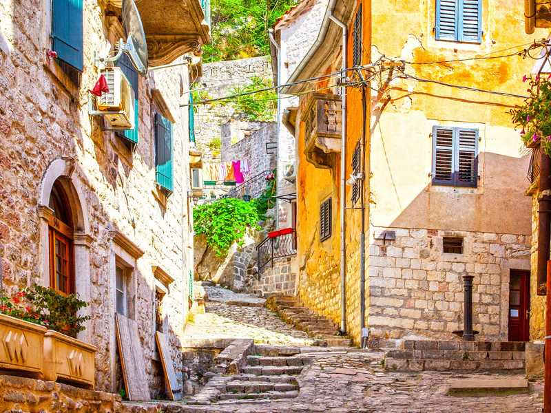 Colorful cobblestoned street in Kotor Montenegro