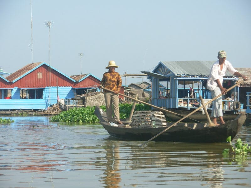 Two men on a boat in Battambang Cambodia