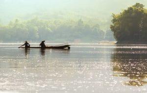 Men in boat on Mekong in Laos