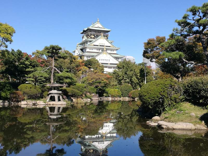 Osaka Castle reflected in pond